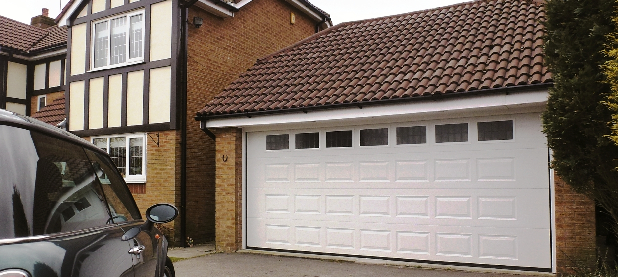 Crocodile garage doors cost wageuzi for 16 x 10 garage door cost